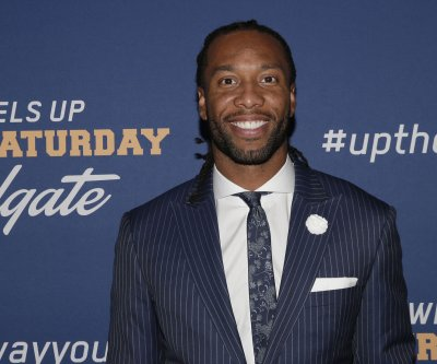 Arizona Cardinals' Larry Fitzgerald buys part of NBA's Phoenix Suns