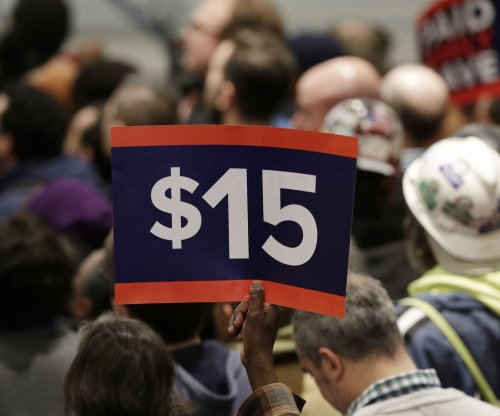 Governors of N.Y., California approve $15 minimum wage hikes; states differ on tipped workers
