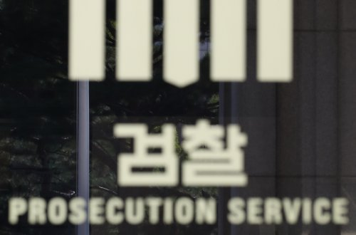 South Korean court to review arrest warrant for ex-minister's wife