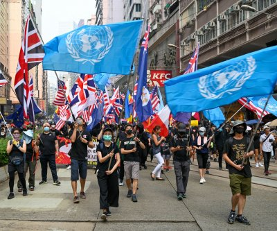 Britain considering opening citizenship to some in Hong Kong