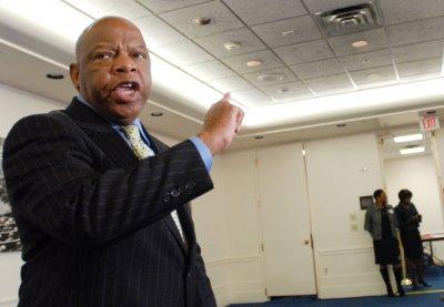 Rep. backs Clinton despite robo-calls