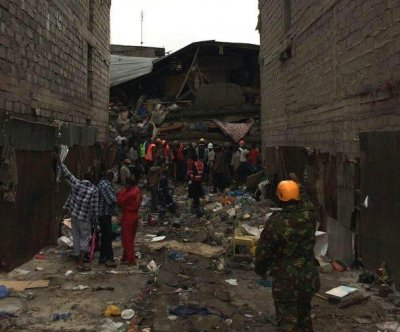 At least 12 dead, in apartment collapse as flooding continues in Kenya