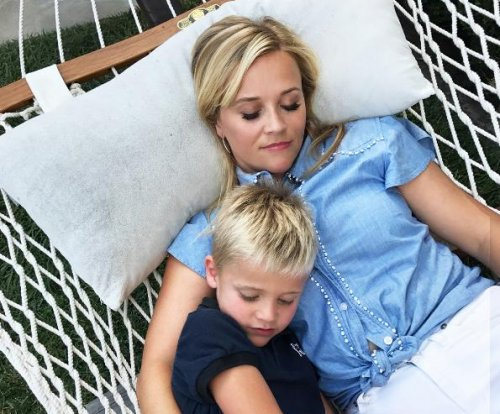 Reese Witherspoon snuggles with her son Tennessee in new photo
