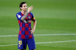 Lionel Messi says he will remain at Barcelona: 'It was a tough decision'