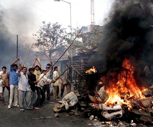 Indian court convicts 24 over anti-Muslim riots where 69 burned to death