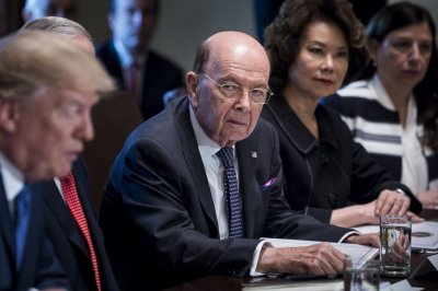 Leaked papers show commerce secretary hid ties to Putin 'cronies'