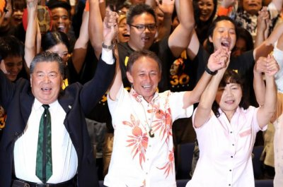 Son of U.S. Marine becomes governor of Okinawa on promise to kick out U.S. military