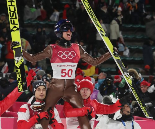 Poland's Kamil Stoch takes gold in Olympic ski jumping
