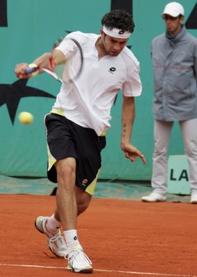 Bolelli wins with two tie-breakers