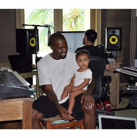 Kim Kardashian shares photo of North visiting Kanye West at recording studio