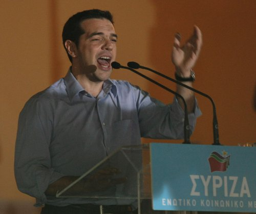 Left-wing Syriza leader Alexis Tsipras becomes new Greek Prime Minister