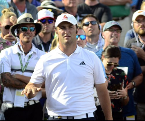 Jon Rahm on top at Congressional in pro debut