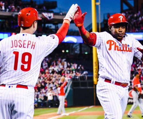 12 runs in first inning lift Philadelphia Phillies past Washington Nationals