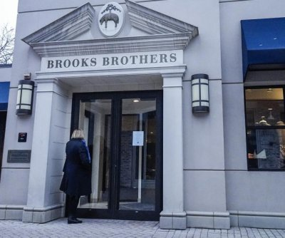 Brooks Brothers files bankruptcy to aid sale