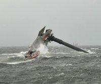 1 dead, 12 missing after ship capsizes off Louisiana coast