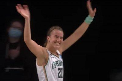WNBA's Sabrina Ionescu continues hot start, sets triple-double record