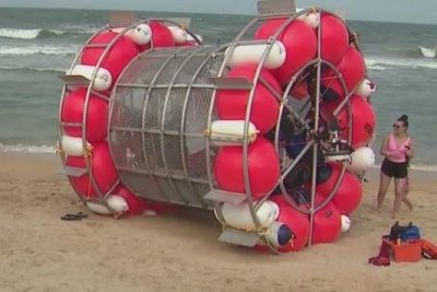 Unusual cylindrical vessel washes up with runner on Florida beach