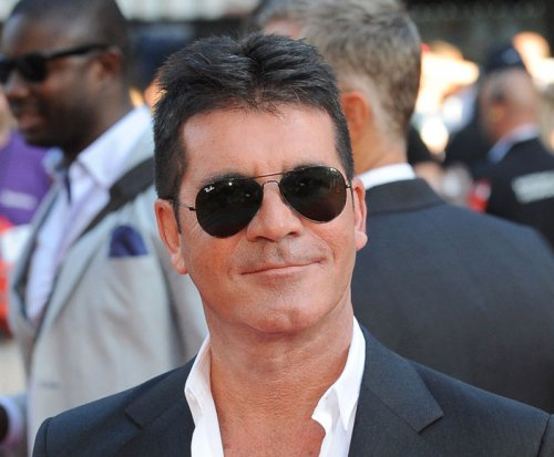Simon Cowell says having son softened his TV critiques