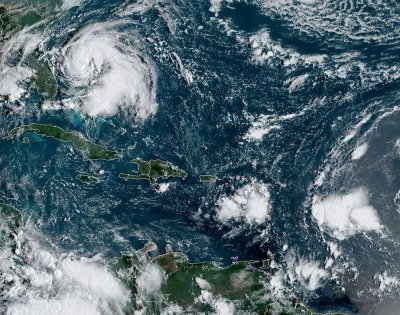Worst of Humberto to steer east of Bahamas, U.S. but surf may be dangerous