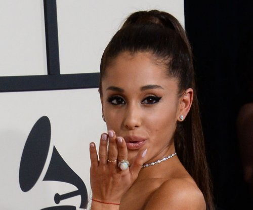 Watch Ariana Grande kiss backup dancer Ricky Alvarez