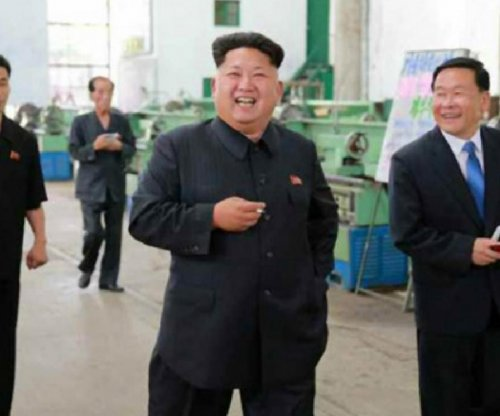 Kim Jong Un expresses rare longing for father at train firm