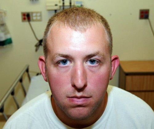 Ferguson officials release photos of Darren Wilson's injuries in Michael Brown case