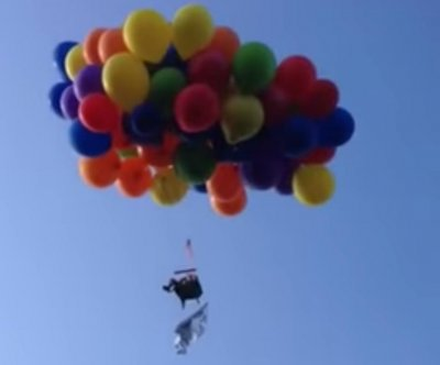 Canadian police arrest man for flight in lawn chair attached to balloons