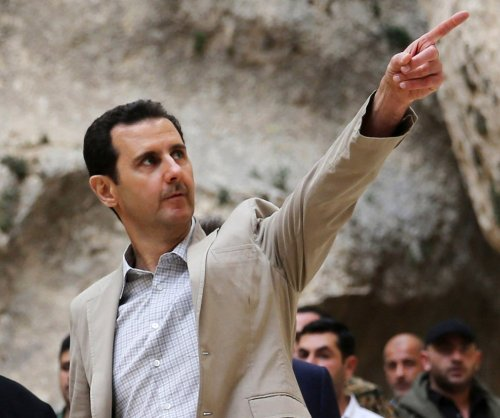 Syria's Assad: 'Confident' of continued Iranian and Russian support