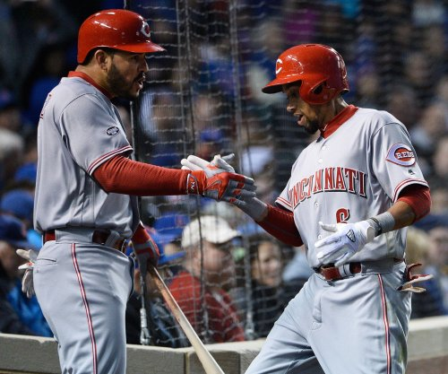 Cincinnati Reds drive by Colorado Rockies