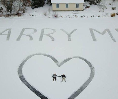 Pilot carves giant message in snow to propose to girlfriend