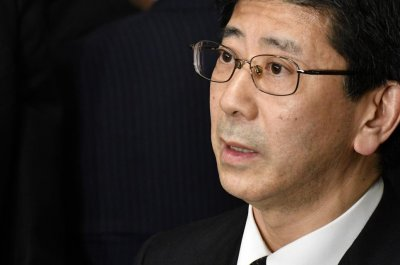 Japan's ex-tax chief denies Abe involvement in land scandal