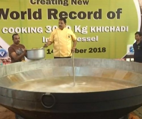 Indian chef cooks 6,614 pounds of khichdi for Guinness record