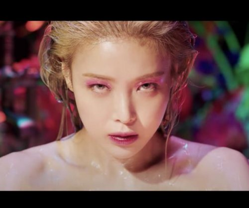 Yubin emerges from tub in 'Perfume' music video teaser