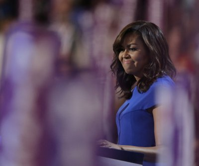 Michelle Obama lauds Clinton as example for young girls everywhere