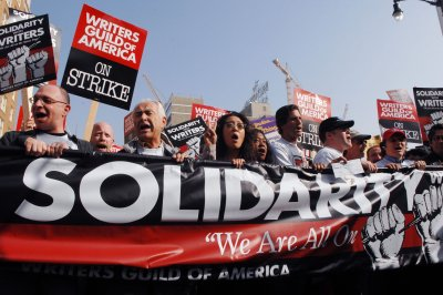 Writers Guild of America members authorize strike; talks with producers to resume Tuesday