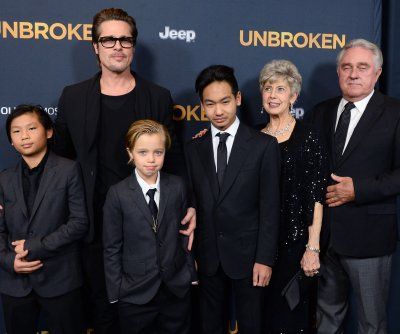 Brad Pitt, son Knox bond at the race track