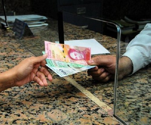 Venezuela issues new banknotes, coins a month behind schedule
