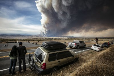 Biden offers $50 billion to fight West wildfires, boosts firefighter pay