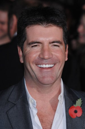 Cowell of 'Idol' engaged to makeup artist