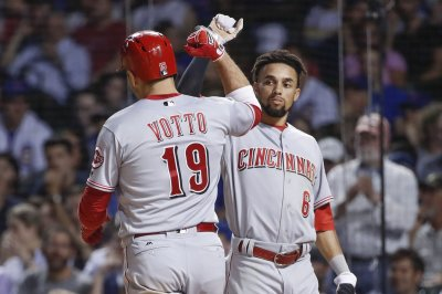 Cincinnati Reds bash four homers in win over Milwaukee Brewers