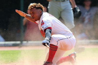 Indians 3B Jose Ramirez carted off after fouling ball off knee
