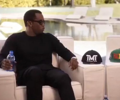 Diddy, Wahlberg bet big on Mayweather vs. Pacquiao