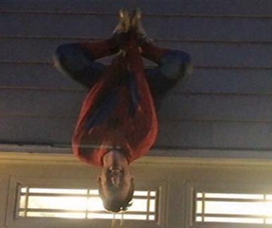 Teen dangles upside-down for Spider-Man promposal