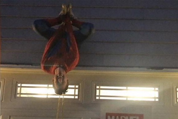 watch spider man hangs upside down to ask girl to prom upi com