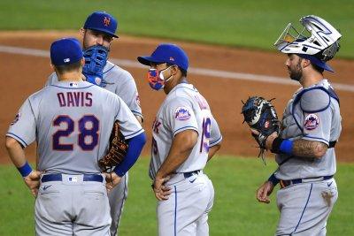 Mets' games vs. Marlins, Yankees postponed after positive COVID-19 tests