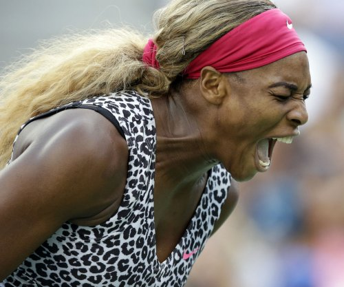 Serena Williams wins, Caroline Wozniacki upset by Victoria Azarenka at Australian Open