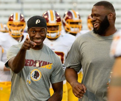 Redskins' RG3 keeps faith after benching