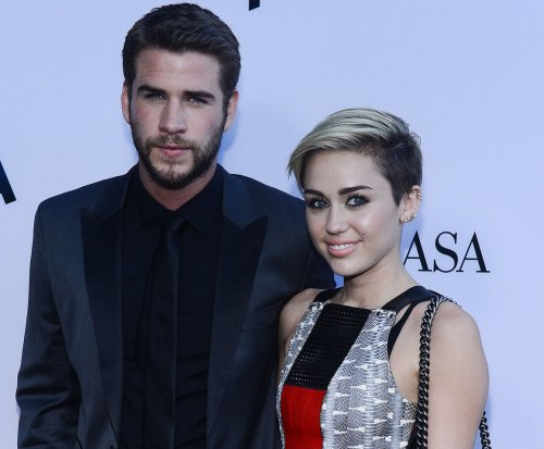Liam Hemsworth joins Miley Cyrus after her BBMAs performance