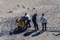 Boston woman rescued after sinking into mud near the beach
