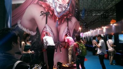 Gamers put heads in giant breasts at Tokyo Game Show